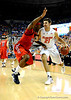 (Casey Brooke Lawson / Gator Country) UF forward Dan Werner moves the ball past Ole Miss forward Murphy Holloway during the Gators 78 to 68 victory over the Rebels in Gainesville, Fla., on January 10, 2009.