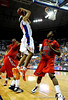 (Casey Brooke Lawson / Gator Country) UF forward Alex Tyus scores over Ole Miss guard Terrico White during the Gators 78 to 68 victory over the Rebels in Gainesville, Fla., on January 10, 2009.