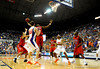 (Casey Brooke Lawson / Gator Country) Ole Miss player forward malcom White attempts to grab the ball for his teammate David Huertas [former UF player 2005-2006] during the Gators 78 to 68 victory over the Rebels in Gainesville, Fla., on January 10, 2009.