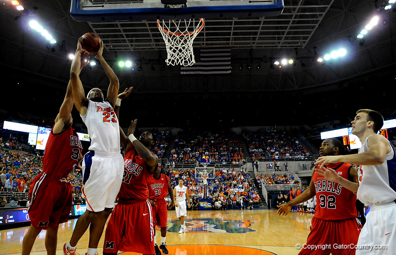 (Casey Brooke Lawson / Gator Country) UF forward Alex Tyus attempts to score over an Ole Miss player during the Gators 78 to 68 victory over the Rebels in Gainesville, Fla., on January 10, 2009.
