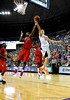 (Casey Brooke Lawson / Gator Country) UF forward Nick Calathes scores over Ole Miss forward Malcom White during the Gators 78 to 68 victory over the Rebels in Gainesville, Fla., on January 10, 2009.