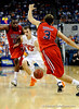 (Casey Brooke Lawson / Gator Country) UF forward Nick Calathes attempts to move the ball past Ole Miss guard Will Bogan during the Gators 78 to 68 victory over the Rebels in Gainesville, Fla., on January 10, 2009.