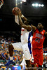 (Casey Brooke Lawson / Gator Country) UF forward Ray Shipman attempts to score over Ole Miss forward Malcom White during the Gators 78 to 68 victory over the Rebels in Gainesville, Fla., on January 10, 2009.