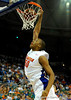 (Casey Brooke Lawson / Gator Country) UF forward Kenny Kadji scores over Ole Miss guard David Huertas [former UF player 2005-2006] during the Gators 78 to 68 victory over the Rebels in Gainesville, Fla., on January 10, 2009.
