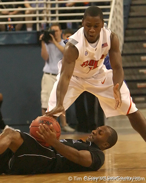 photo by Tim Casey<br /> <br /> Florida freshman guard Erving Walker reaches for a loose ball during the second half of the Gators' 108-49 win in an exhibition game against the Warner Southern Royals on Monday, November 3, 2008 at the Stephen C. O'Connell Center in Gainesville, Fla.