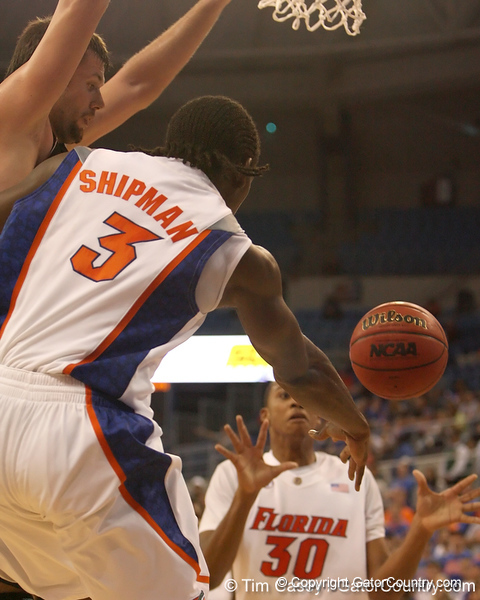 photo by Tim Casey<br /> <br /> Florida freshman guard/forward Ray Shipman passes to freshman forward/center Kenny Kadji during the second half of the Gators' 108-49 win in an exhibition game against the Warner Southern Royals on Monday, November 3, 2008 at the Stephen C. O'Connell Center in Gainesville, Fla.