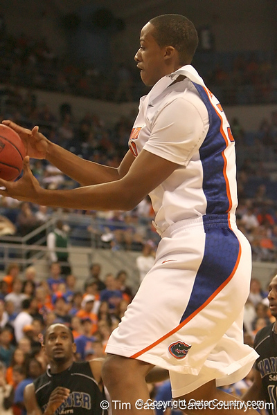photo by Tim Casey<br /> <br /> Florida freshman forward/center Kenny Kadji grabs an offensive rebound during the first half of the Gators' exhibition game against the Warner Southern Royals on Monday, November 3, 2008 at the Stephen C. O'Connell Center in Gainesville, Fla.