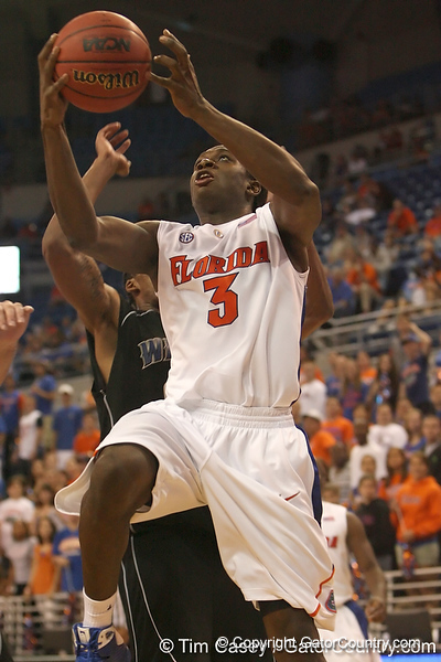 photo by Tim Casey<br /> <br /> Florida freshman guard/forward Ray Shipman gets fouled while shooting a layup during the second half of the Gators' 108-49 win in an exhibition game against the Warner Southern Royals on Monday, November 3, 2008 at the Stephen C. O'Connell Center in Gainesville, Fla. Shipman finished with ten points in 15 minutes of play.