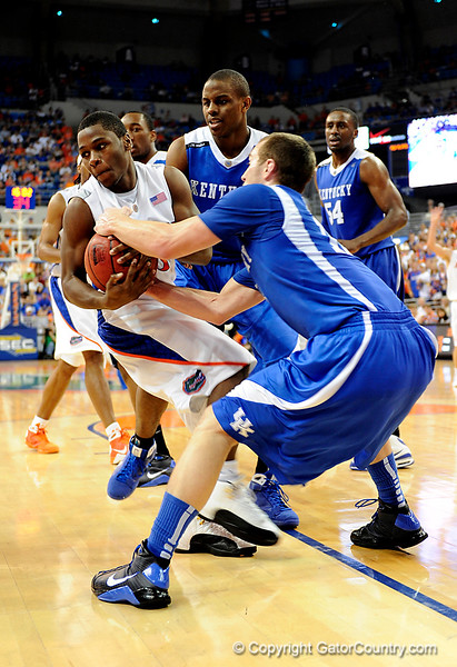 UF guard Erving Walker attempts to pull the ball away from a Kentucky player during the University of Florida Gators 60-53 victory over the Kentucky Wildcats on Friday, March 6, 2009 in the Steven C. O'Connell Center. / Gator Country photo by Casey Brooke lawson