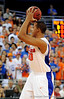 UF forward Kenny Kadji looks to pass the ball around a Kentucky player during the University of Florida Gators 60-53 victory over the Kentucky Wildcats on Friday, March 6, 2009 in the Steven C. O'Connell Center. / Gator Country photo by Casey Brooke lawson