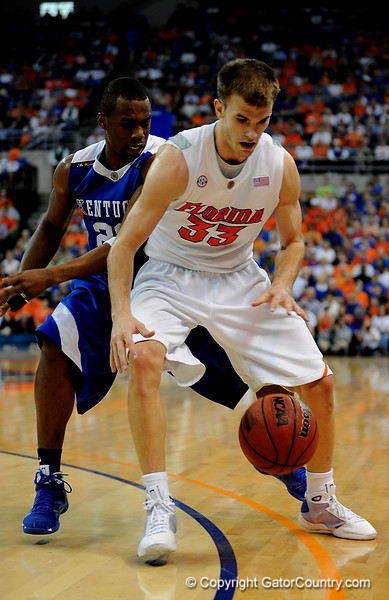 UF forward Nick Calathes attempts to move the ball around a Kentucky player during the University of Florida Gators 60-53 victory over the Kentucky Wildcats on Friday, March 6, 2009 in the Steven C. O'Connell Center. / Gator Country photo by Casey Brooke lawson