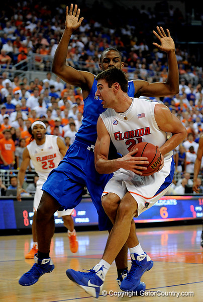 UF forward Dan Werner moves the ball around a Kentucky player during the University of Florida Gators 60-53 victory over the Kentucky Wildcats on Friday, March 6, 2009 in the Steven C. O'Connell Center. / Gator Country photo by Casey Brooke lawson