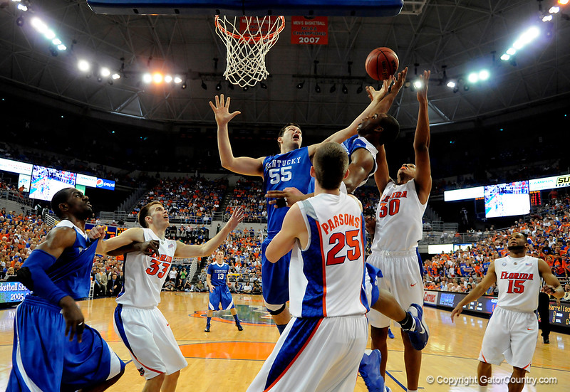 Kentucky's Josh Harrellson attempts to grab a rebound during the University of Florida Gators 60-53 victory over the Kentucky Wildcats on Friday, March 6, 2009 in the Steven C. O'Connell Center. / Gator Country photo by Casey Brooke lawson