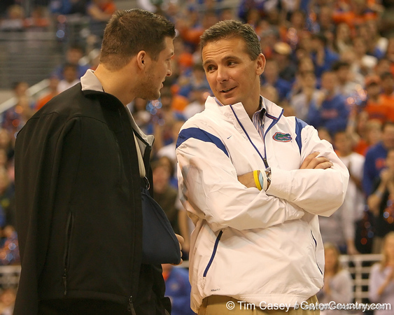 photo by Tim Casey<br /> <br /> Florida junior quarterback Tim Tebow talks with head coach Urban Meyer during halftime of the Gators' 80-65 win against the Arkansas Razorback on on Saturday, January 17, 2009 at the Stephen C. O'Connell Center in Gainesville, Fla.