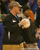photo by Tim Casey<br /> <br /> Florida redshirt senior long snapper James Smith and junior running back Kestahn Moore bring the crystal football from the Coaches' Trophy onto the court during halftime of the Gators' 80-65 win against the Arkansas Razorback on on Saturday, January 17, 2009 at the Stephen C. O'Connell Center in Gainesville, Fla.