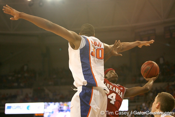 photo by Tim Casey<br /> <br /> Courtney Fortson attempts to shoot around Florida freshman forward/center Kenny Kadji during first half of the Gators' 80-65 win against the Arkansas Razorbacks on Saturday, January 17, 2009 at the Stephen C. O'Connell Center in Gainesville, Fla.