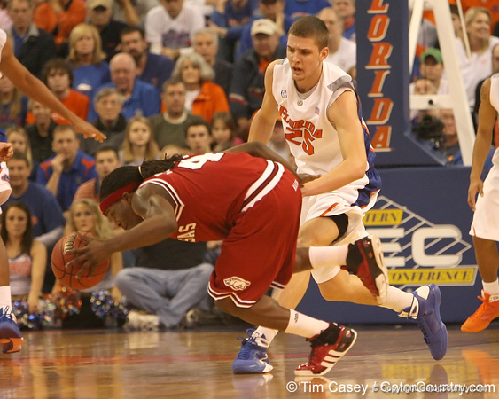 photo by Tim Casey<br /> <br /> Florida sophomore forward Chandler Parsons defends Courtney Fortson during first half of the Gators' 80-65 win against the Arkansas Razorbacks on Saturday, January 17, 2009 at the Stephen C. O'Connell Center in Gainesville, Fla.