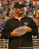 photo by Tim Casey<br /> <br /> Florida redshirt senior defensive tackle Javier Estopinan holds the crystal football from the Coaches' Trophy during halftime of the Gators' 80-65 win against the Arkansas Razorback on on Saturday, January 17, 2009 at the Stephen C. O'Connell Center in Gainesville, Fla.
