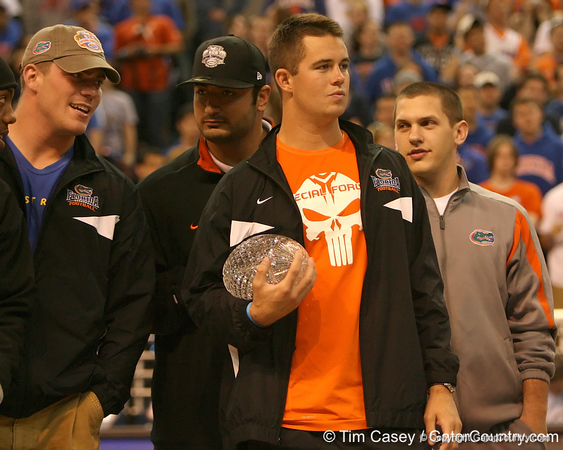 photo by Tim Casey<br /> <br /> Florida redshirt senior Butch Rowley holds the crystal football from the Coaches' Trophy during halftime of the Gators' 80-65 win against the Arkansas Razorback on on Saturday, January 17, 2009 at the Stephen C. O'Connell Center in Gainesville, Fla.