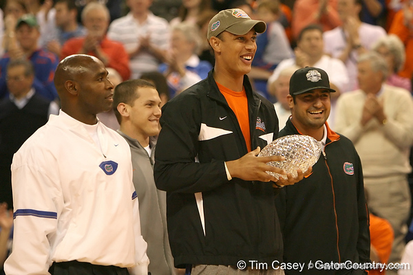 photo by Tim Casey<br /> <br /> Florida redshirt junior wide receiver David Nelson brings the crystal football from the Coaches' Trophy onto the court during halftime of the Gators' 80-65 win against the Arkansas Razorback on on Saturday, January 17, 2009 at the Stephen C. O'Connell Center in Gainesville, Fla.