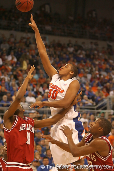 photo by Tim Casey<br /> <br /> Florida freshman forward/center Kenny Kadji shoots a jump shot during first half of the Gators' 80-65 win against the Arkansas Razorbacks on Saturday, January 17, 2009 at the Stephen C. O'Connell Center in Gainesville, Fla.