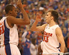 photo by Tim Casey<br /> <br /> Florida sophomore guard/forward Nick Calathes congratulates Kenny Kadji during first half of the Gators' 80-65 win against the Arkansas Razorback on Saturday, January 17, 2009 at the Stephen C. O'Connell Center in Gainesville, Fla.