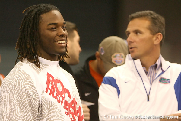 photo by Tim Casey<br /> <br /> Trent Richardson jokes with Florida head football coach Urban Meyer during first half of the Gators' 80-65 win against the Arkansas Razorbacks on Saturday, January 17, 2009 at the Stephen C. O'Connell Center in Gainesville, Fla.
