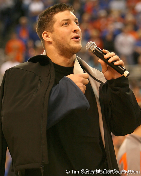 photo by Tim Casey<br /> <br /> Florida junior quarterback Tim Tebow takes his arm out of a sling and tells fans his arm will be fine during the Gators' 80-65 win against the Arkansas Razorback on on Saturday, January 17, 2009 at the Stephen C. O'Connell Center in Gainesville, Fla.
