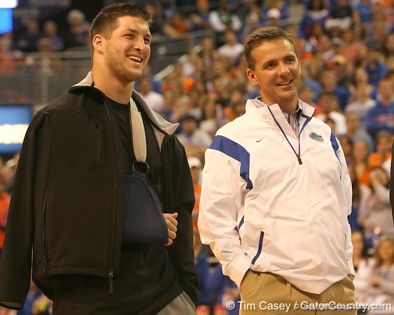 photo by Tim Casey<br /> <br /> Florida junior quarterback Tim Tebow and Florida head coach Urban Meyer listen during halftime of the Gators' 80-65 win against the Arkansas Razorback on on Saturday, January 17, 2009 at the Stephen C. O'Connell Center in Gainesville, Fla.