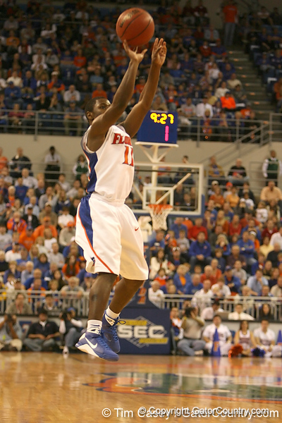 photo by Tim Casey<br /> <br /> Florida freshman guard Erving Walker attempts a three-pointer during the Gators' 80-65 win against the Arkansas Razorback on on Saturday, January 17, 2009 at the Stephen C. O'Connell Center in Gainesville, Fla.