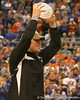 photo by Tim Casey<br /> <br /> Florida redshirt senior long snapper James Smith holds the crystal football from the Coaches' Trophy during halftime of the Gators' 80-65 win against the Arkansas Razorback on on Saturday, January 17, 2009 at the Stephen C. O'Connell Center in Gainesville, Fla.