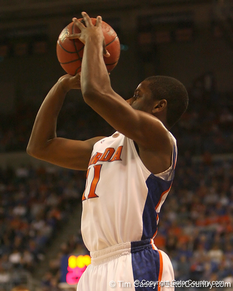 photo by Tim Casey<br /> <br /> Florida freshman guard Erving Walker shoots for a three pointer during first half of the Gators' 80-65 win against the Arkansas Razorbacks on Saturday, January 17, 2009 at the Stephen C. O'Connell Center in Gainesville, Fla.