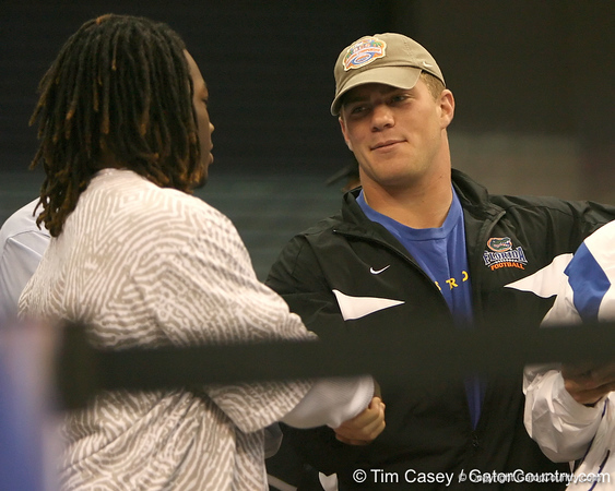 photo by Tim Casey<br /> <br /> Florida redshirt senior long snapper James Smith shakes hands with a recruit during first half of the Gators' 80-65 win against the Arkansas Razorbacks on Saturday, January 17, 2009 at the Stephen C. O'Connell Center in Gainesville, Fla.