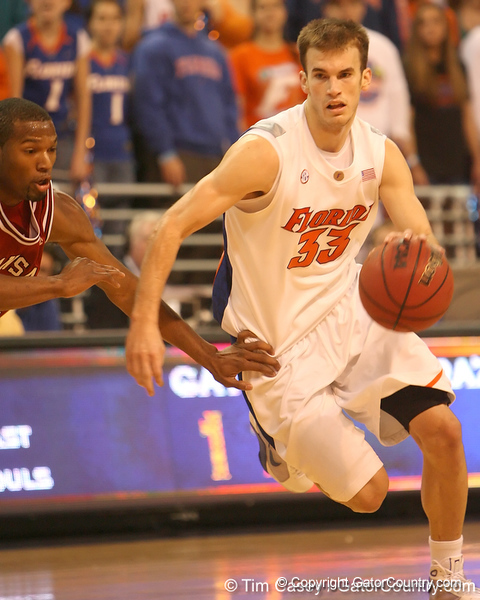 photo by Tim Casey<br /> <br /> Florida sophomore guard/forward Nick Calathes dribbles towards the goal during first half of the Gators' 80-65 win against the Arkansas Razorback on Saturday, January 17, 2009 at the Stephen C. O'Connell Center in Gainesville, Fla.