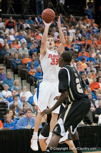 Photo by Tim Darby <br /> <br /> Nick Calathes shoots for three at the University of Florida vs. University of Central Florida Basketball game at the Veterans Memorial Arena in Jacksonville, FL on December 20, 2008.