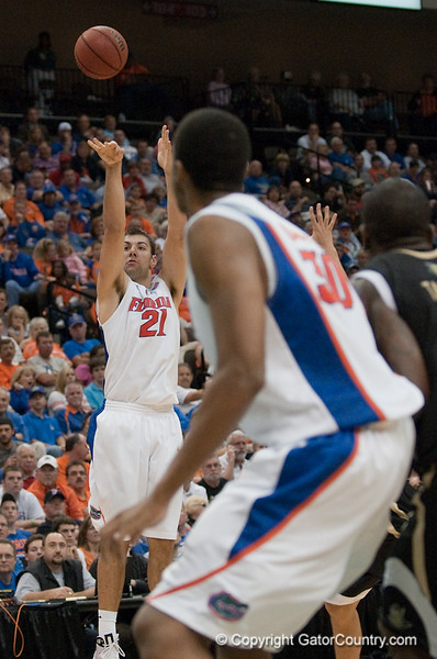 Photo by Tim Darby <br /> <br /> Dan Werner shoots for three at the University of Florida vs. University of Central Florida Basketball game at the Veterans Memorial Arena in Jacksonville, FL on December 20, 2008.