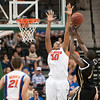 Photo by Tim Darby <br /> <br /> Kenny Kadji attempts to block a shot at the University of Florida vs. University of Central Florida Basketball game at the Veterans Memorial Arena in Jacksonville, FL on December 20, 2008.
