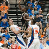 Photo by Tim Darby <br /> <br /> Dan Werner attempts to draw a charge at the University of Florida vs. University of Central Florida Basketball game at the Veterans Memorial Arena in Jacksonville, FL on December 20, 2008.