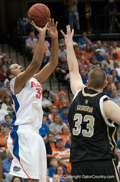 Photo by Tim Darby <br /> <br /> Kenny Kadji shoots a jumpshot at the University of Florida vs. University of Central Florida Basketball game at the Veterans Memorial Arena in Jacksonville, FL on December 20, 2008.