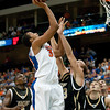 Photo by Tim Darby <br /> <br /> Kenny Kadji puts up a shot at the University of Florida vs. University of Central Florida Basketball game at the Veterans Memorial Arena in Jacksonville, FL on December 20, 2008.