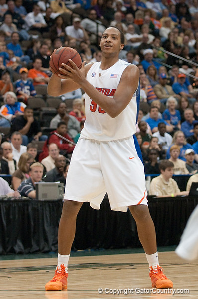 Photo by Tim Darby <br /> <br /> Kenny Kadji looks to pass at the University of Florida vs. University of Central Florida Basketball game at the Veterans Memorial Arena in Jacksonville, FL on December 20, 2008.