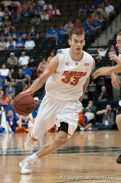 Photo by Tim Darby <br /> <br /> Nick Calathes dribbles around the perimeter at the University of Florida vs. University of Central Florida Basketball game at the Veterans Memorial Arena in Jacksonville, FL on December 20, 2008.