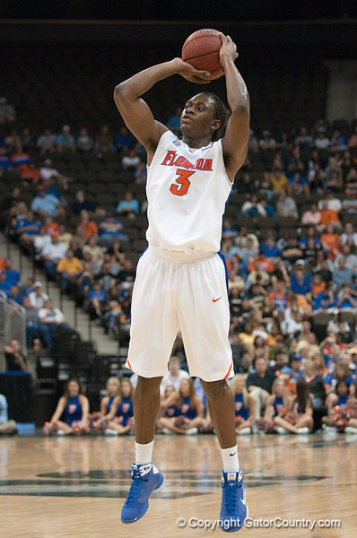 Photo by Tim Darby <br /> <br /> Ray Shipman shoots for three at the University of Florida vs. University of Central Florida Basketball game at the Veterans Memorial Arena in Jacksonville, FL on December 20, 2008.