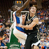Photo by Tim Darby <br /> <br /> Erving Walker follows through on a shot at the University of Florida vs. University of Central Florida Basketball game at the Veterans Memorial Arena in Jacksonville, FL on December 20, 2008.