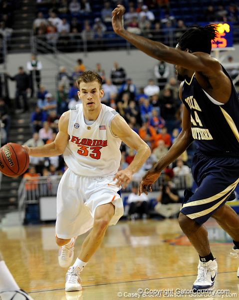 photo by Casey Brooke Lawson<br /> <br /> Florida sophomore guard/forward Nick Calathes moves the ball past a Georgia Southern player in the second half. The Gators beat the Eagles 88 to 81 at the O'Connell Center in Gainesville, Fla. on December 22, 2008.