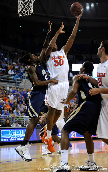 photo by Casey Brooke Lawson<br /> <br /> Florida freshman forward/center Kenny Kadji scores over a Georgia Southern player in the first half. The Gators beat the Eagles 88 to 81 at the O'Connell Center in Gainesville, Fla. on December 22, 2008