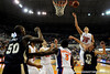 photo by Casey Brooke Lawson<br /> <br /> Florida sophomore forward Chandler Parsons scores over Georgia Southern guard Colby Wohlleb.The Gators beat the Eagles 88 to 81 at the O'Connell Center in Gainesville, Fla. on December 22, 2008.