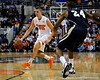photo by Casey Brooke Lawson<br /> <br /> Florida sophomore forward Chandler Parsons moves the ball past Georgia Southern guard Julian Allen. The Gators beat the Eagles 88 to 81 at the O'Connell Center in Gainesville, Fla. on December 22, 2008