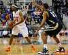 photo by Casey Brooke Lawson<br /> <br /> Florida sophomore forward Alex Tyus moves the ball past Georgia Southern forward Sandy Perry. The Gators beat the Eagles 88 to 81 at the O'Connell Center in Gainesville, Fla. on December 22, 2008.