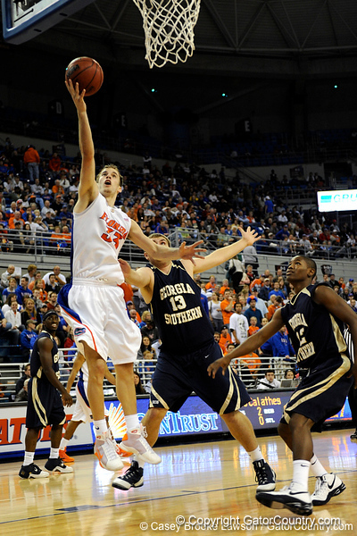photo by Casey Brooke Lawson<br /> <br /> Florida sophomore guard/forward Nick Calathes scores over Georgia Southern center Krysztof Janiszewski in the first half of the Gators game against Georgia Southern. The Gator's beat the Eagles 88 to 81 at the O'Connell Center in Gainesville, Fla. on December 22, 2008
